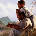 Dad and son with Bible